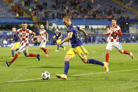 Sweden's Martin Olsson runs with the ball during the UEFA Nations League soccer match between Croatia and Sweden at the Maksimir stadium in Zagreb, Croatia