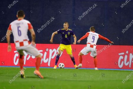 Sweden's Ludwig Augustinsson (L) and Croatia's Andrej Kramaric (R) in action during the UEFA Nations League group A3 soccer match between Croatia and Sweden in Split, Croatia, 11 October 2020.