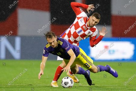Sweden's Albin Ekdal (L) and Croatia's Mateo Kovacic (R) in action during the UEFA Nations League group A3 soccer match between Croatia and Sweden in Split, Croatia, 11 October 2020.