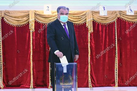 Tajik President Emomali Rahmon votes at a polling station in Dushanbe, Tajikistan, Oct. 11, 2020. Tajikistan's presidential election began on Sunday, with five candidates including incumbent President Emomali Rahmon running for the post.