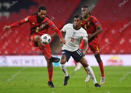 Stock Photo of Marcus Rashford of England (C) in action against Jason Denayer (L) and Dedryck Boyata of Belgium (R) during the UEFA Nations League match between England and Belgium in London, Britain, 11 October 2020.