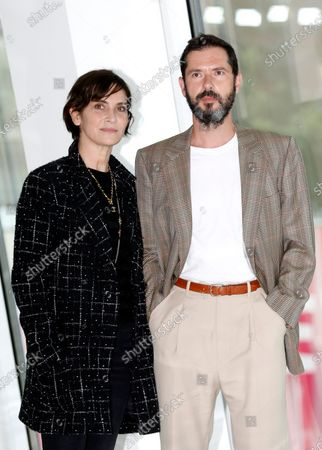 Geraldine Pailhas (L) and French actor Melvil Poupaud (R) pose during a photocall for the TV series 'OVNI(s)' at the Cannes Series Festival, in Cannes, France, 11 October 2020. The event runs from 09 to 14 October.