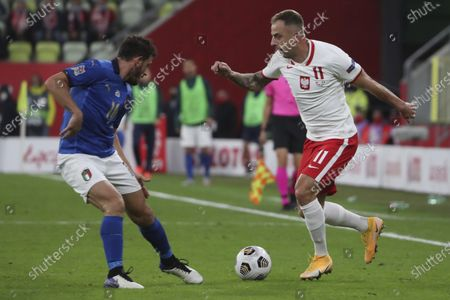 Poland's Kamil Grosicki, right, is challenged by Italy's Alessandro Florenzi during the UEFA Nations League soccer match between Poland and Italy at Energa stadium in Gdansk, Poland