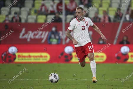 Poland's Kamil Grosicki runs with the ball during the UEFA Nations League soccer match between Poland and Italy at Energa stadium in Gdansk, Poland