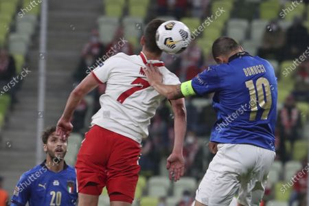 Stock Picture of Italy's Leonardo Bonucci, right, jumps for the ball with Poland's Arkadiusz Milik during the UEFA Nations League soccer match between Poland and Italy at Energa stadium in Gdansk, Poland