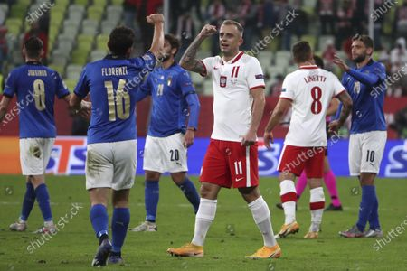 Italy's Alessandro Florenzi, left, cheers Poland's Kamil Grosicki end of the UEFA Nations League soccer match between Poland and Italy at Energa stadium in Gdansk, Poland