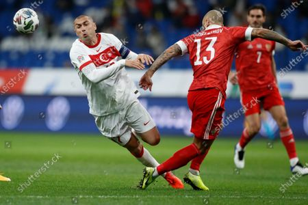 Turkey's Burak Yilmaz, left, and Russia's Fyodor Kudryashov battle for the ball during the UEFA Nations League soccer match between Russia and Turkey at Dinamo Stadium in Moscow, Russia