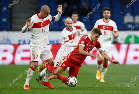 Russia's Roman Zobnin, right, falls as Turkey's Burak Yilmaz, left, watches during the UEFA Nations League soccer match between Russia and Turkey at Dinamo Stadium in Moscow, Russia
