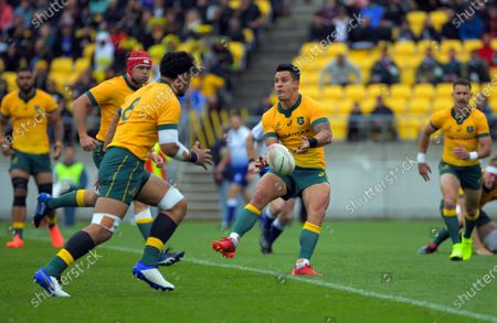 Australia's Matt To'omua passes during the Bledisloe Cup rugby union match between the New Zealand All Blacks and Australia Wallabies at Sky Stadium in Wellington, New Zealand on Sunday, 11 October 2020.