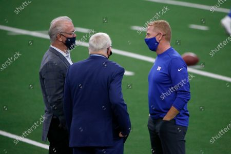 New York Giants offensive coordinator Jason Garrett, right, talks with Dallas Cowboys owner Jerry Jones, center, and chief operating officer Stephen Jones, left, before an NFL football game in Arlington, Texas