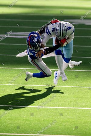 New York Giants cornerback Logan Ryan (23) tackles Dallas Cowboys quarterback Dak Prescott (4) during an NFL football game against the New York Giants, in Arlington, Texas. Prescott would suffer a severe right leg injury on the play and leave the game on the play. Dallas won 37-34