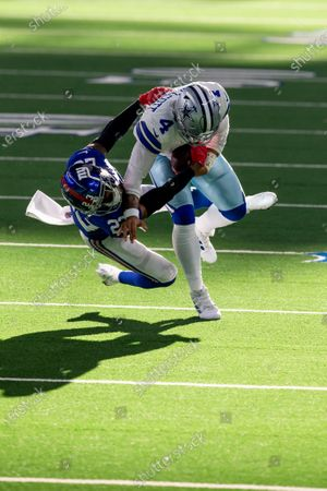 New York Giants cornerback Logan Ryan (23) tackles Dallas Cowboys quarterback Dak Prescott (4) during an NFL football game, in Arlington, Texas. Prescott would suffer a severe right leg injury on the play and leave the game on the play. Dallas won 37-34