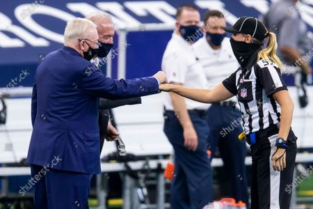 Dallas Cowboys Vice President Stephen Jones, back, and owner Jerry Jones fist bump down judge Sarah Thomas (52) before an NFL football game against the New York Giants, in Arlington, Texas. Dallas won 37-34