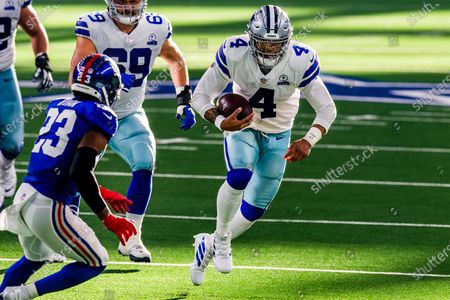 Dallas Cowboys quarterback Dak Prescott (4) looks for room against New York Giants cornerback Logan Ryan (23) during an NFL football game, in Arlington, Texas. Prescott would suffer a severe right leg injury on the play and would leave the game. Dallas won 37-34