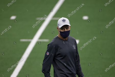 Dallas Cowboys defensive coordinator Mike Nolan, stand son the field during team warmups before an NFL football game against the New York Giants in Arlington, Texas