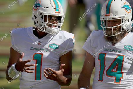 Miami Dolphins quarterback Tua Tagovailoa (1) and quarterback Ryan Fitzpatrick (14) on the field before an NFL football game against the San Francisco 49ers, in Santa Clara, Calif