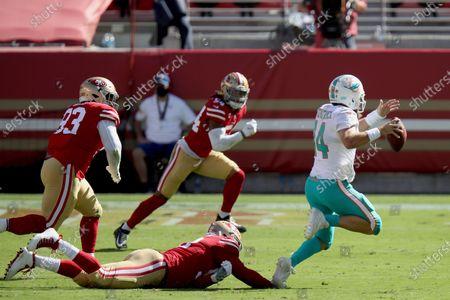 San Francisco 49ers defensive end Kerry Hyder Jr.(92) sacks Miami Dolphins quarterback Ryan Fitzpatrick (14) during an NFL football game, in Santa Clara, Calif