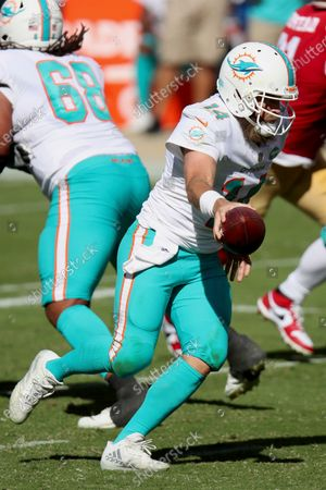 Miami Dolphins quarterback Ryan Fitzpatrick (14) in action during an NFL football game against the San Francisco 49ers, in Santa Clara, Calif