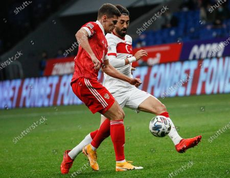 Roman Zobnin (L) of Russia in action against Mahmut Tekdemir (R) of Turkey during the UEFA Nations League soccer match between Russia and Turkey at the VTB Arena in Moscow, Russia, 11 October 2020.