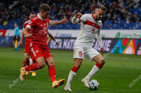 Roman Zobnin (L) of Russia in action against Kenan Karaman (R) of Turkey during the UEFA Nations League soccer match between Russia and Turkey at the VTB Arena in Moscow, Russia, 11 October 2020.