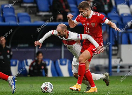 Roman Zobnin (R) of Russia in action against Efecan Karaca (L) of Turkey during the UEFA Nations League soccer match between Russia and Turkey at the VTB Arena in Moscow, Russia, 11 October 2020.