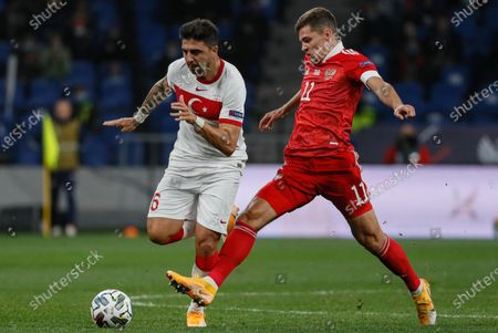 Roman Zobnin (R) of Russia in action against Ozan Tufan (L) of Turkey during the UEFA Nations League soccer match between Russia and Turkey at the VTB Arena in Moscow, Russia, 11 October 2020.