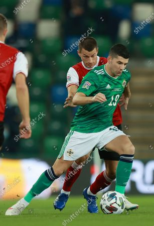 Stock Picture of Jordan Jones of Northern Ireland (R) in action against Stefan Lainer of Austria (L) during the UEFA Nations League match between Northern Ireland and Austria in Belfast, Britain, 11 October 2020.