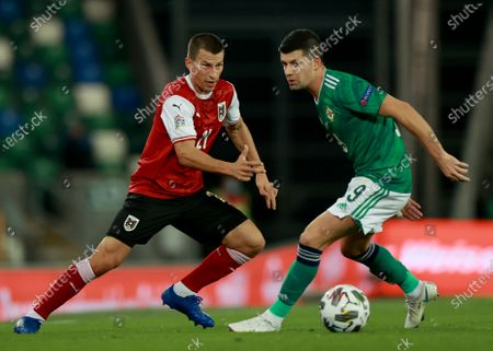 Jordan Jones of Northern Ireland (R) in action against Stefan Lainer of Austria (L) during the UEFA Nations League match between Northern Ireland and Austria in Belfast, Britain, 11 October 2020.