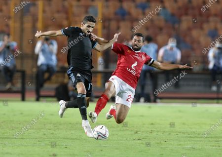 Al-Ahly  player Ahmed Fathy (R) in action against Pyramids player Mohamed Farouk (L) during the Egyptian Premier League soccer match between Al-Ahly and Pyramids at Salam Stadium in Cairo Egypt, 11 October 2020.