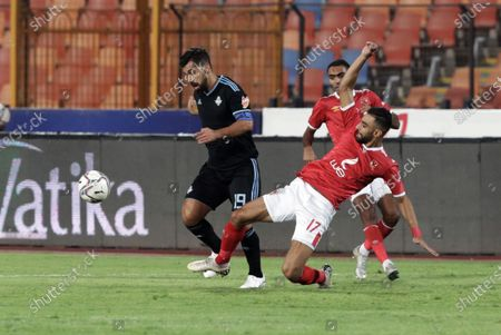 Al-Ahly player Amro Elsoulia (R) in action against Pyramids player Abdallah El Said (L) during the Egyptian Premier League soccer match between Al-Ahly and Pyramids at Salam Stadium in Cairo Egypt, 11 October 2020.
