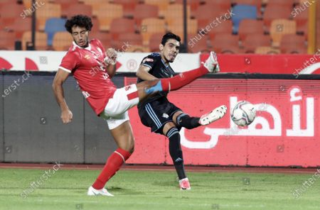 Stock Image of Al-Ahly player Mohamed Hany (L) in action against Pyramids player Mahmoud Hamdy (R) during the Egyptian Premier League soccer match between Al-Ahly and Pyramids at Salam Stadium in Cairo Egypt, 11 October 2020.