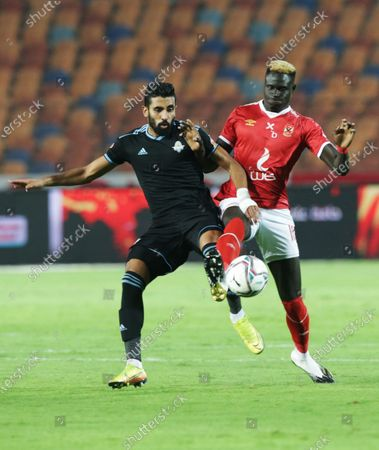 Al-Ahly player Aliou Badji (R) in action against Pyramids player Abdallah El Said (L) during the Egyptian Premier League soccer match between Al-Ahly and Pyramids at Salam Stadium in Cairo Egypt, 11 October 2020.