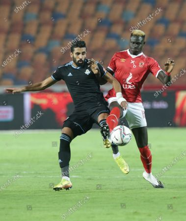 Al-Ahly player Aliou Badji(R) in action against Pyramids player Abdallah El Said (L) during the Egyptian Premier League soccer match between Al-Ahly and Pyramids at Salam Stadium in Cairo Egypt, 11 October 2020.
