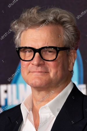 Actor Colin Firth poses for photographers during the photo call for the film 'Supernova', as part of London Film Festival at the BFI Southbank, in central London