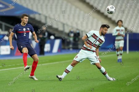 France player Benjamin Pavard (L) fights for the ball with Bruno Fernandes (R) of Portugal during the UEFA Nations League soccer match between France and Portugal at Stade de France, Paris, France, 11 October 2020.