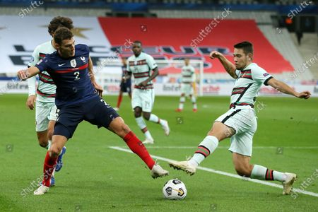 France player Benjamin Pavard (L) fights for the ball with Raphael Guerreiro (R) of Portugal during the UEFA Nations League soccer match between France and Portugal at Stade de France, Paris, France, 11 October 2020.