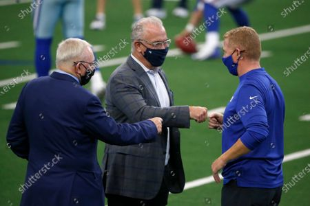 Stock Photo of Dallas Cowboys team owner Jerry Jones, left, Stephen Jones, center, and New York Giants offensive coordinator Jason Garrett, right, greet each other before an NFL football game in Arlington, Texas, . The game marks the first time Garrett has returned to play against the team he was the head coach of last season