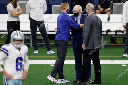Dallas Cowboys team owner Jerry Jones, center, and Stephen Jones, right, greet New York Giants offensive coordinator Jason Garrett, left, before an NFL football game in Arlington, Texas, . The game marks the first time Garrett has returned to play against the team he was the head coach of last season