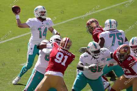 Miami Dolphins quarterback Ryan Fitzpatrick (14) passes against the San Francisco 49ers during the first half of an NFL football game in Santa Clara, Calif