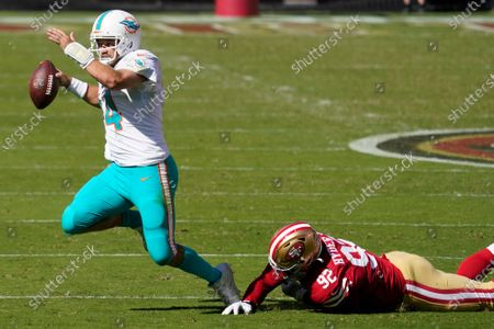 San Francisco 49ers defensive end Kerry Hyder Jr. (92) sacks Miami Dolphins quarterback Ryan Fitzpatrick (14) during the first half of an NFL football game in Santa Clara, Calif