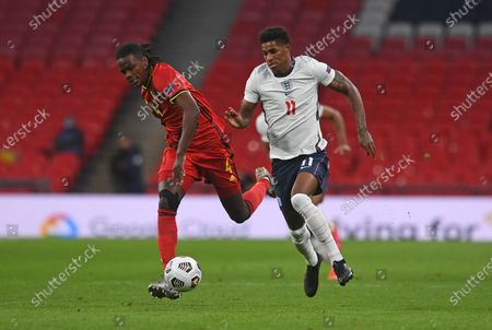 Belgium's Dedryck Boyata, left, and England's Marcus Rashford during the UEFA Nations League soccer match between England and Belgium at Wembley stadium in London