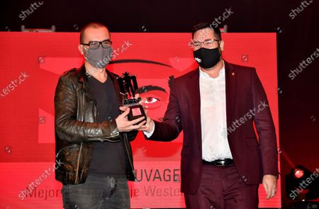 Stock Photo of David Perrault (L) receives the best 'Western film 2020' for his film 'L'etat Sauvage' during Western Film Festival 2020 held in Tabernes, Almeria, Spain, 11 October 2020.