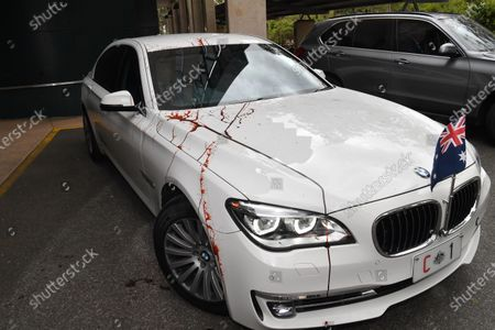 The Prime Ministers car is smeared in fake blood and tomatoes by refugee protestors at the University of Queensland Vaccine Lab during a visit by Australian Prime Minister Scott Morrison in Brisbane, Australia, 12 October 2020. Prime Minister Morrison was touring the University of Queensland's Vaccine Lab to look over their research as they try to develop a vaccine for the coronavirus.
