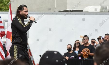 UFC fighter Jorge Masvidal speaks before Donald Trump Jr at a Fighters Against Socialism campaign rally in support of U.S. President Donald Trump.  This was the second of three such events held that day across the state.