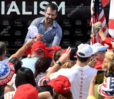 Stock Image of Donald Trump Jr signs autographs after speaking during a Fighters Against Socialism campaign rally in support of his father, U.S. President Donald Trump. UFC fighter Jorge Masvidal also spoke at the event.
