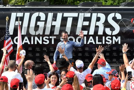 Donald Trump Jr waves to supporters as he prepares to depart after speaking during a Fighters Against Socialism campaign rally in support of his father, U.S. President Donald Trump. UFC fighter Jorge Masvidal also spoke at the event.