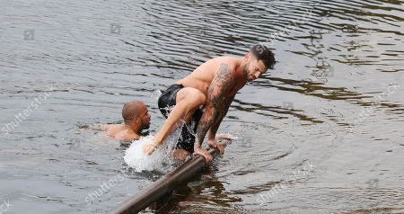 Jake Quickenden and Kieron Dyer who were swimming in Portree harbour, ahead of filming 'Celebrity SAS: Who Dares Wins' on the neighbouring island of Raasay