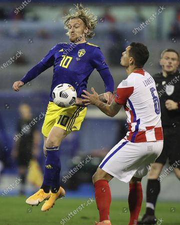 Emil Forsberg (L) of Sweden vies with Dejan Lovren of Croatia during their UEFA Nations League Group 3 match in League A in Zagreb, Croatia, Oct. 11, 2020. Croatia won 2-1.