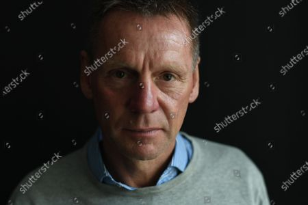"Stock Picture of Stuart Pearce - There is a passage in the prologue of Never Stop Dreaming, Stuart Pearce's new retrospective on Terry Venables's England team and their fondly remembered journey to the semi-finals of Euro 96, where the man formerly known as Psycho ponders the roles of love and hate in football and how they can become the drivers that encourage different players to compete and excel. 'I saw something in the paper the other day,' writes Pearce, a former England caretaker manager and England Under-21 boss, 'and the question was, ""Are you motivated by love or hate when you play football and which is the more powerful?"" Interesting question. If it were me, I would edge towards hate.' He thinks about that as he sits in an office in London's West End, about how raw aggression used to play more of a part in the game for players in the Eighties and Nineties. 'You had to fight your corner,' he says, 'otherwise you were going home.' He thinks about how he would have adapted if he were playing today when 'defenders are afraid to touch attackers'. Maybe his nickname would not have been Psycho if he were playing now? 'Maybe,' he says. 'But I don't think it would have been Tippy Toes, either.' He talks about how he used to try to intimidate players by playing up to his slightly deranged, violent reputation. 'I was always in control,' he says. 'The worst thing you can do is be out of control when you cross that white line. My outward emotions did not reflect what I was feeling on the inside. It was how I portrayed myself to the opposition. It was just to make my job easier.'"