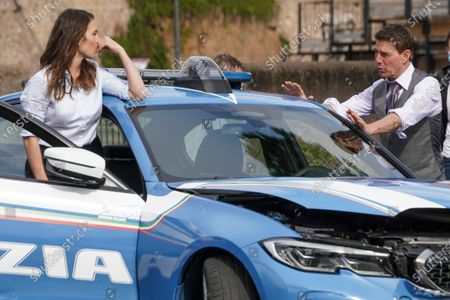 Actors Tom Cruise, right, and Hayley Atwell perform during the shooting of the film Mission Impossible 7, by Christopher McQuarrie, in Rome